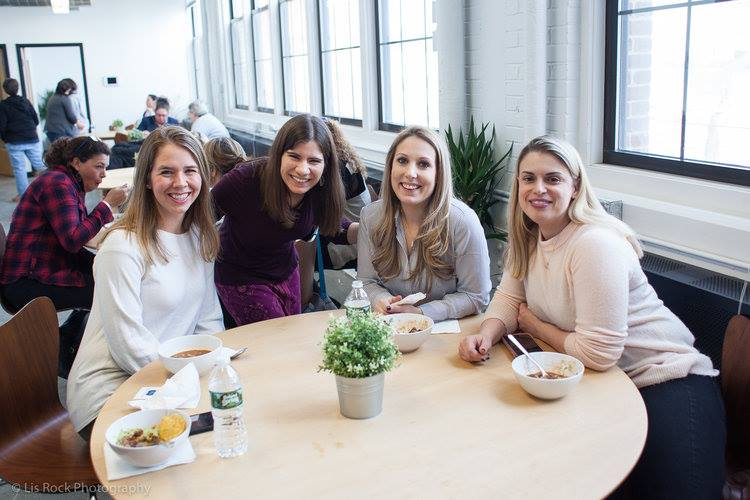 Four women at a networking event. Networking tips for introverts.