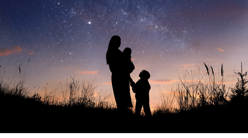 Woman with two children at dusk