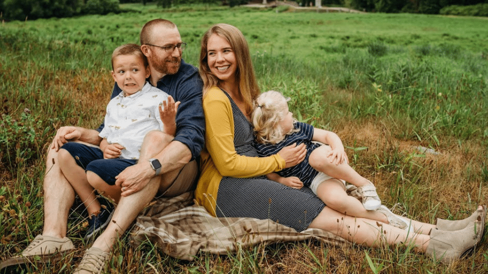 Author of the working mom book, Becca Carnahan, with her husband and two children.